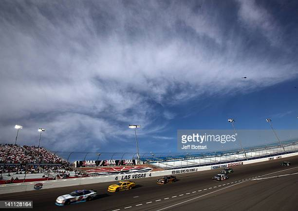 Elliott Sadler driver of the OneMain Financial Chevrolet leads a pack of cars during the NASCAR Nationwide Series Sam's Town 300 at Las Vegas Motor...