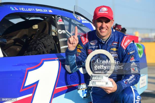 Elliott Sadler driver of the OneMain Financial Chevrolet poses for a photo opportunity with the regular season championship trophy following the...