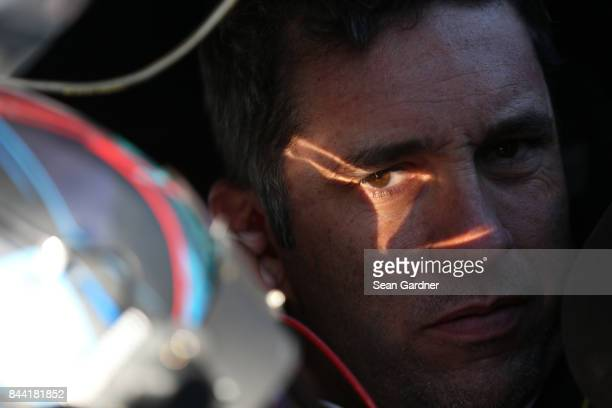 Elliott Sadler driver of the OneMain Financial Chevrolet sits in his car during practice for the NASCAR XFINITY Series Virginia529 College Savings...
