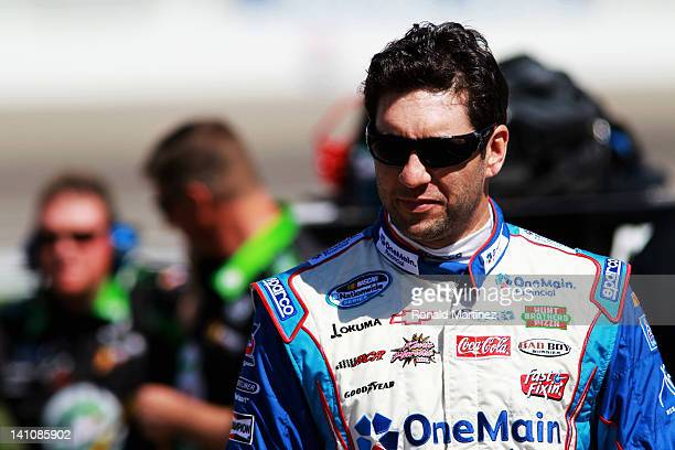 Elliott Sadler driver of the OneMain Financial Chevrolet stands on the grid during qualifying for the NASCAR Nationwide Series Sam's Town 300 at Las...