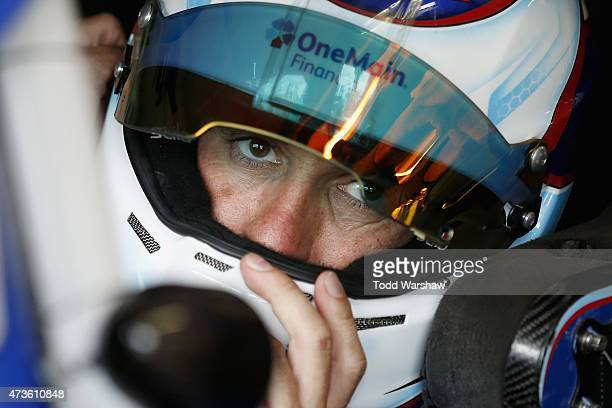 Elliott Sadler driver of the OneMain Financial Ford prepares to drive during practice for the NASCAR Xfinity Series 3M 250 at Iowa Speedway on May 16...