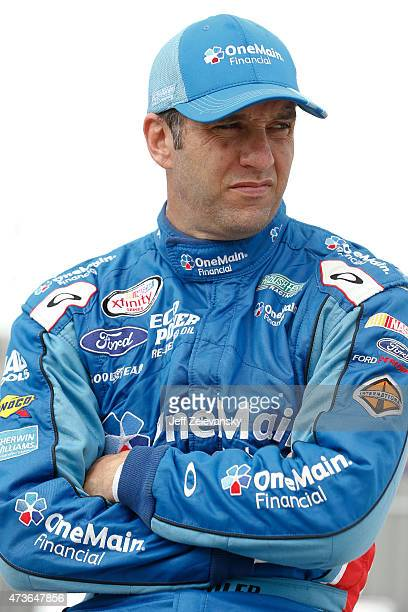 Elliott Sadler driver of the OneMain Financial Ford stands on the grid during qualifying for the NASCAR XFinity Series 3M 250 at Iowa Speedway on May...