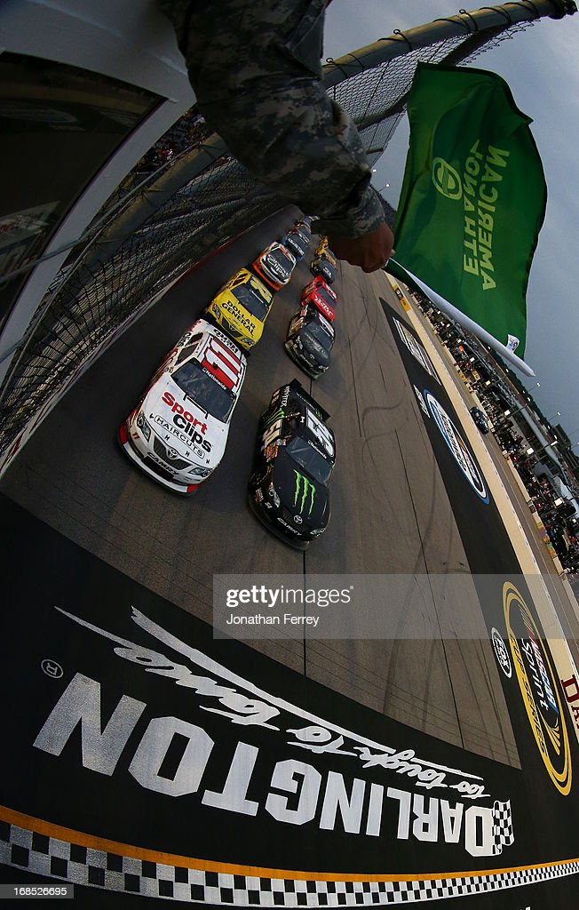 Elliott Sadler, driver of the #11 SportClips Toyota and Kyle Busch, driver of the #54 Monster Energy Toyota, lead the field at the start of the NASCAR Nationwide Series VFW Sport Clips Help A Hero 200 at Darlington Raceway on May 10, 2013 in Darlington, South Carolina.