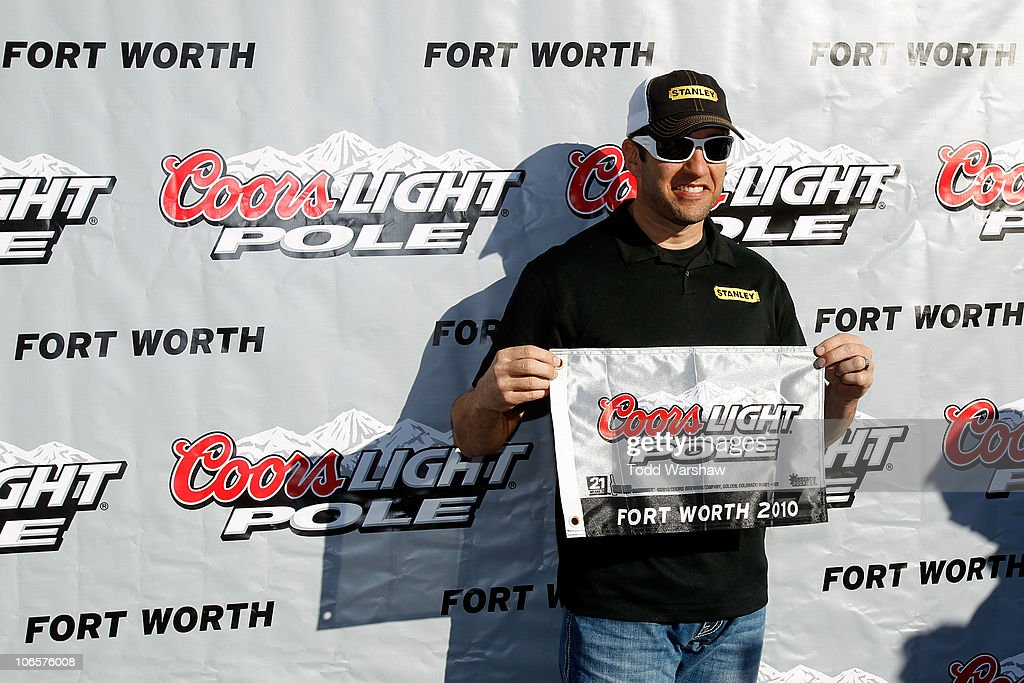 Elliott Sadler, driver of the #19 Stanley Ford, poses in Victory Lane after qualifying for the pole position in the NASCAR Sprint Cup Series AAA Texas 500 at Texas Motor Speedway on November 5, 2010 in Fort Worth, Texas.