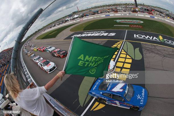 Elliott Sadler driver of the US Cellular Chevrolet takes the green flag to start the NASCAR Xfinity Series US Cellular 250 presented by The Rasmussen...