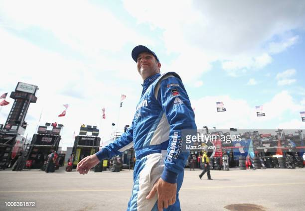 Elliott Sadler driver of the US Cellular Chevrolet walks to his car during practice for the NASCAR Xfinity Series US Cellular 250 Presented by...
