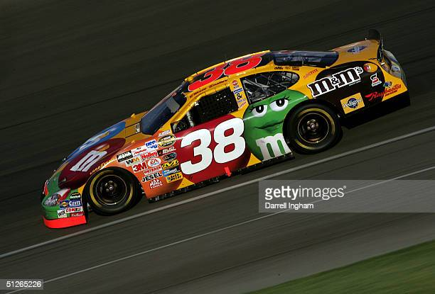 Elliott Sadler drives the MMs Ford during the NASCAR Nextel Cup Series Pop Secret 500 on September 5 2004 at California Speedway in Fontana California