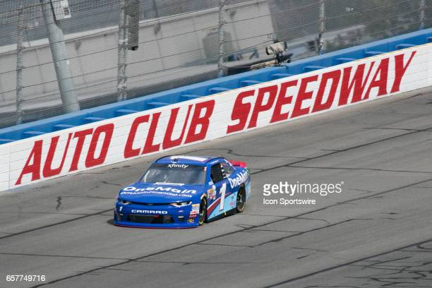Elliott Sadler drives the OneMain Financial Chevrolet car on a high line as he steers around turn during qualifying for the Xfinity Series 19th...