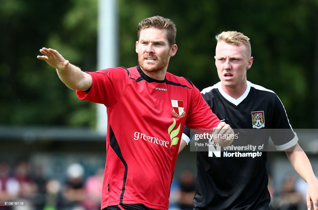 Elliott Sandy of Sileby Rangers and Jarvis Wilson of Northampton Town look on during a Pre-Season Friendly Match between Sileby Rangers and Northampton Town at Fernie Fields on July 8, 2017 in Northampton, England.