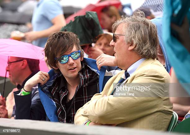 Elliott Spencer and Stephen Fry attend day eight of the Wimbledon Tennis Championships at Wimbledon on July 7 2015 in London England