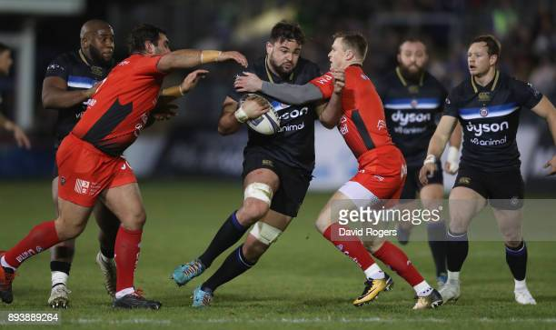 Elliott Stooke of Bath is tackled by Florian Fresia and Chris Ashton during the European Rugby Champions Cup match between Bath Rugby and RC Toulon...