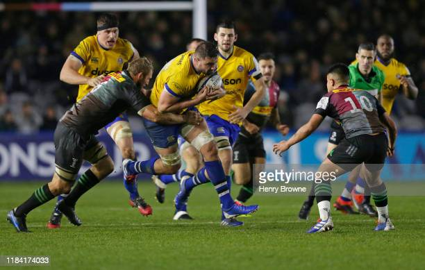 Elliott Stooke of Bath Rugby is tackled by Chris Robshaw of Harlequins during the Heineken Champions Cup Round 2 match between Harlequins and Bath...