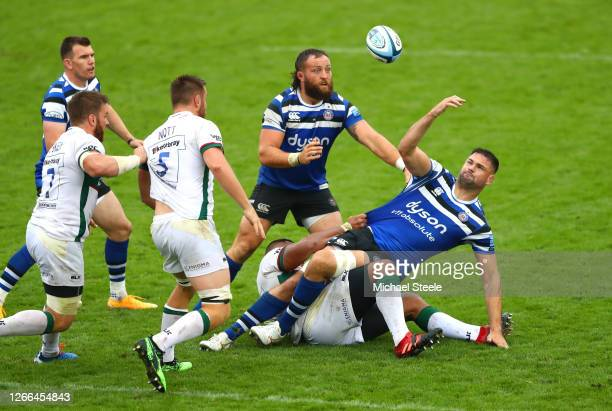 Elliott Stooke of Bath Rugby loses possession of the ball as he is tackled by Sekope Kepu of London Irish during the Gallagher Premiership Rugby...