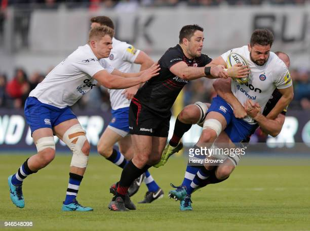 Elliott Stooke of Bath tackled by Schalk Burger and Brad Barritt of Saracens during the Aviva Premiership match between Saracens and Bath Rugby at...