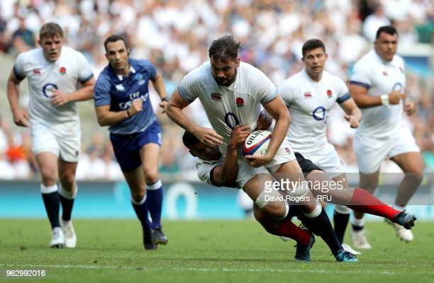 Elliott Stooke of England is tackled during the Quilter Cup match between England and Barbarians at Twickenham Stadium on May 27 2018 in London...