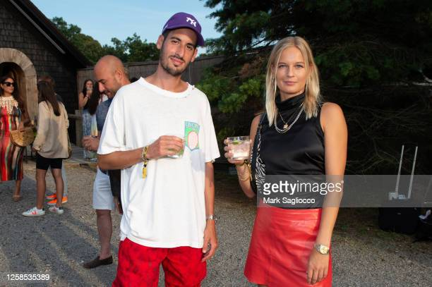 Elliott Tebele and Sandra Winther attend the Hamptons Magazine x The Chainsmokers VIP Dinner at The Barn at Nova's Ark on July 25, 2020 in Watermill,...