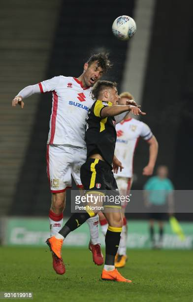 Elliott Ward of Milton Keynes Dons rises above Jerry Yates of Rotherham United to head the ball during the Sky Bet League One match between Milton...
