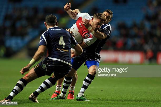 Elliott Whitehead of England is tackled by Danny Brough of Scotland during the Four Nations match between the England and Scotland at The Ricoh Arena...