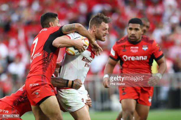 Elliott Whitehead of England is tackled during the 2017 Rugby League World Cup Semi Final match between Tonga and England at Mt Smart Stadium on...