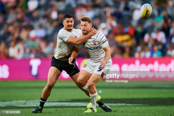 Elliott Whitehead of England is tackled during the semi-final Rugby League World Cup 9s match between New Zealand and England at Bankwest Stadium on...
