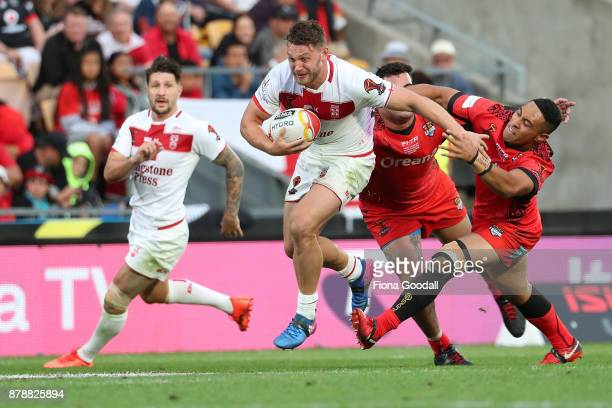 Elliott Whitehead of England makes a break during the 2017 Rugby League World Cup Semi Final match between Tonga and England at Mt Smart Stadium on...