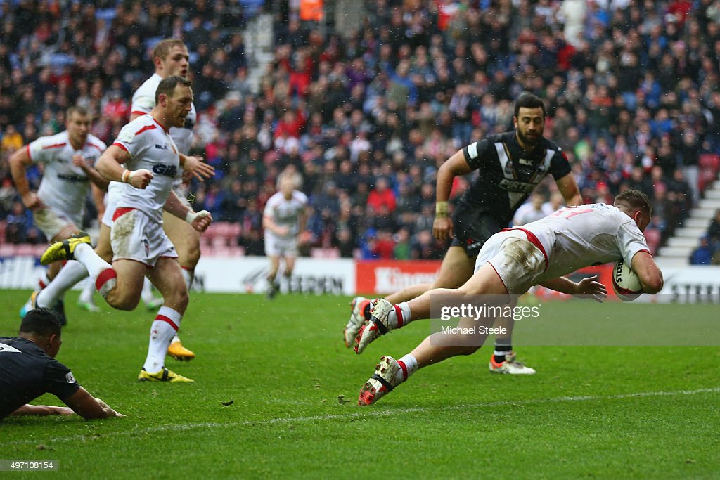 Elliott Whitehead of England scores the opening try during the third International Rugby League Test Series match between England and New Zealand at DW Stadium on November 14, 2015 in Wigan, England.