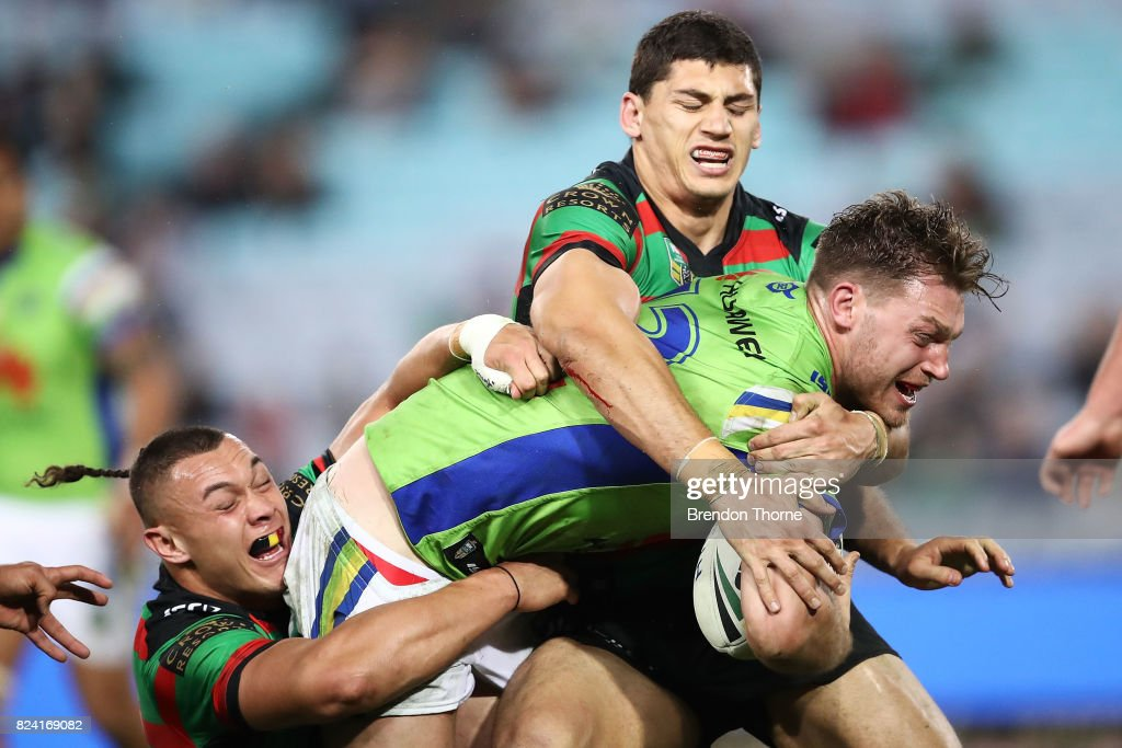 Elliott Whitehead of the Raiders is tackled by the Rabbitohs defence during the round 21 NRL match between the South Sydney Rabbitohs and the Canberra Raiders at ANZ Stadium on July 29, 2017 in Sydney, Australia.