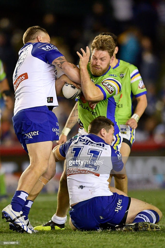 Elliott Whitehead of the Raiders is tackled during the round 17 NRL match between the Canterbury Bulldogs and the Canberra Raiders at Belmore Sports Ground on July 7, 2018 in Sydney, Australia.