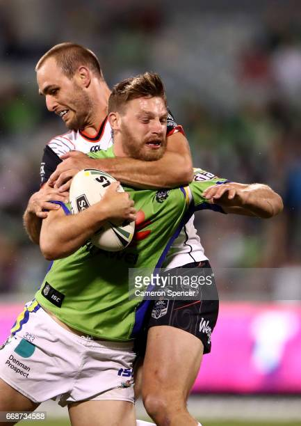 Elliott Whitehead of the Raiders is tackled high during the round seven NRL match between the Canberra Raiders and the New Zealand Warriors at GIO...