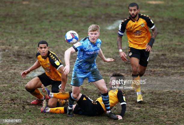 Elliott Whitehouse of Forest Green Rovers is tackled by Josh Sheehan and Priestley Farquharson of Newport County during the Sky Bet League Two match...