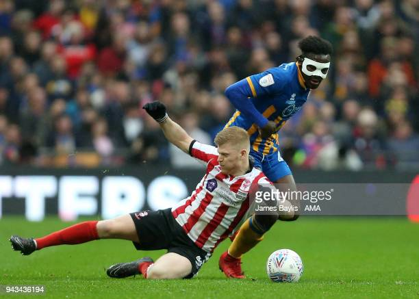 Elliott Whitehouse of Lincoln City and Aristote Nsiala of Shrewsbury Town during the Checkatrade Trophy Final between Lincoln City and Shrewsbury...
