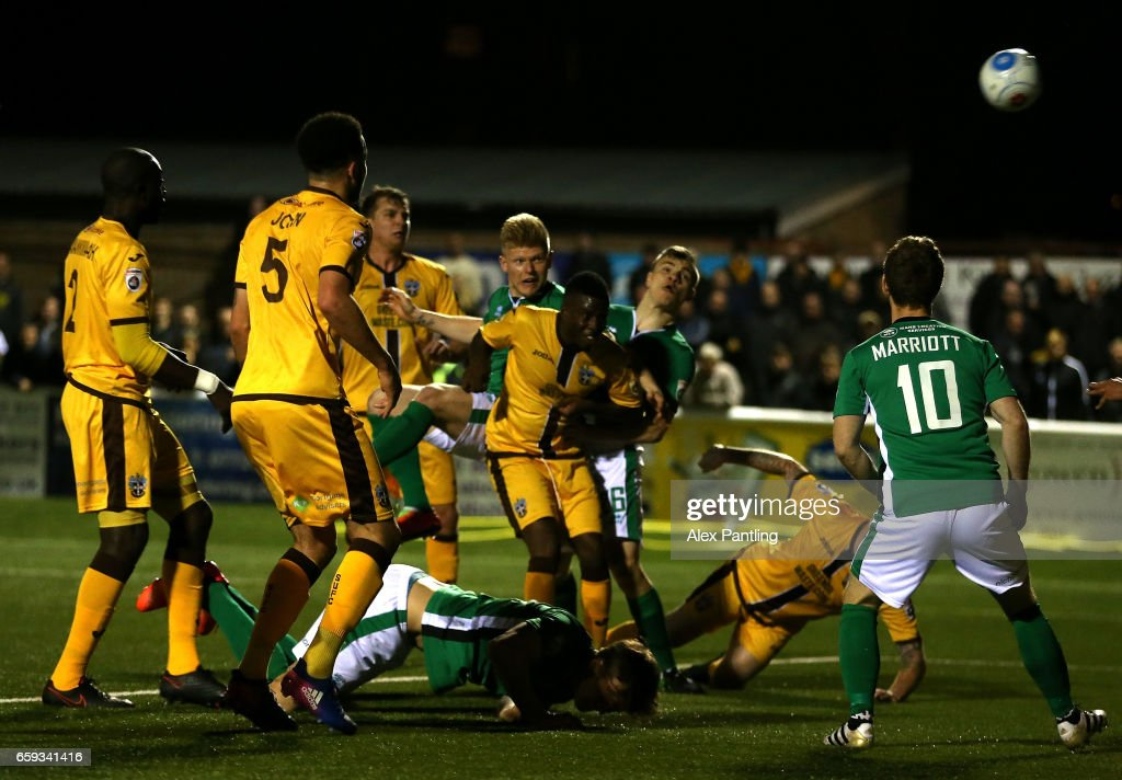 Elliott Whitehouse of Lincoln City scores his sides first goal during the Vanarama National League match between Sutton United and Lincoln City at Gander Green Lane on March 28, 2017 in Sutton, Greater London.