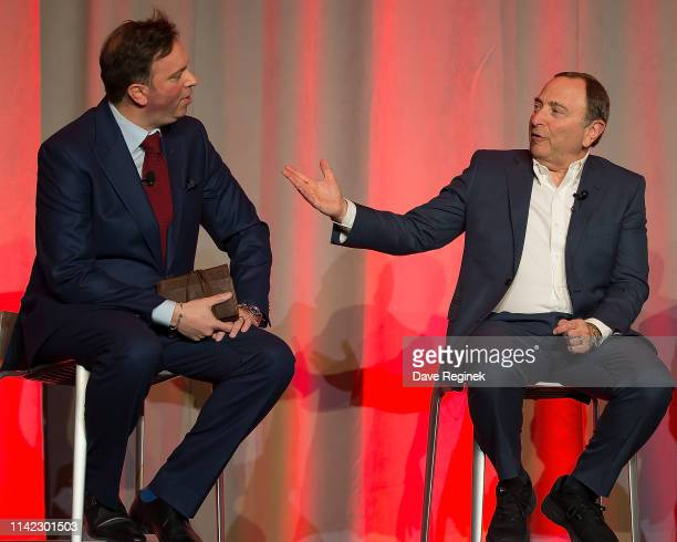 Elliotte Friedman Canadian sports journalist talks with Gary Bettman Commissioner of the National Hockey League during the 2019 NHL Club Business...