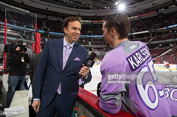Elliotte Friedman interview Erik Karlsson of the Ottawa Senators on Hockey Fights Cancer night prior to a game against the Calgary Flames at Canadian...