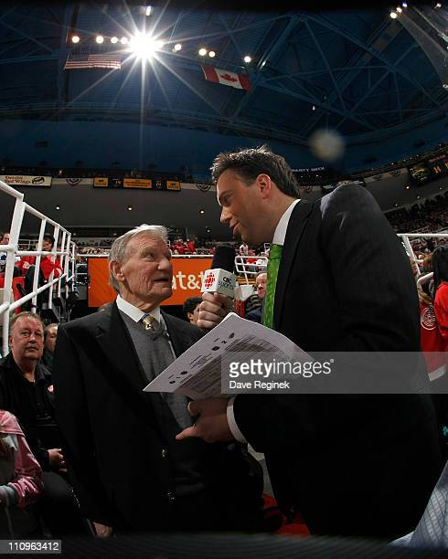 Elliotte Friedman of CBC Sports Canada interviews former Red Wing Jonny Wilson during an NHL game between the Toronto Maple Leafs and the Detroit Red...