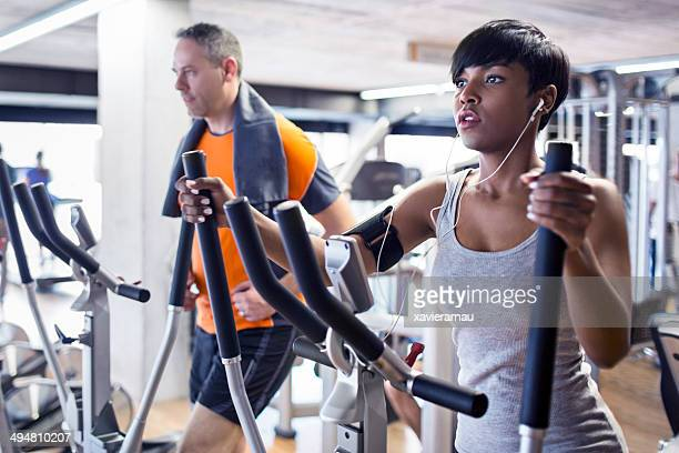 elliptical cross trainer - black female bodybuilder stock photos and pictures