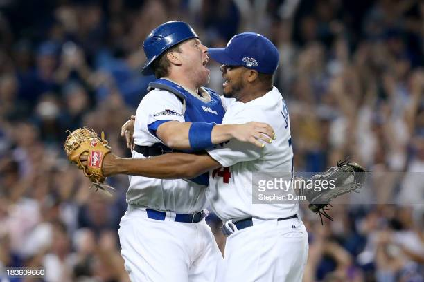J Ellis and Kenley Jansen of the Los Angeles Dodgers celebrate after the Dodgers defeat the Atlanta Braves 43 in Game Four of the National League...