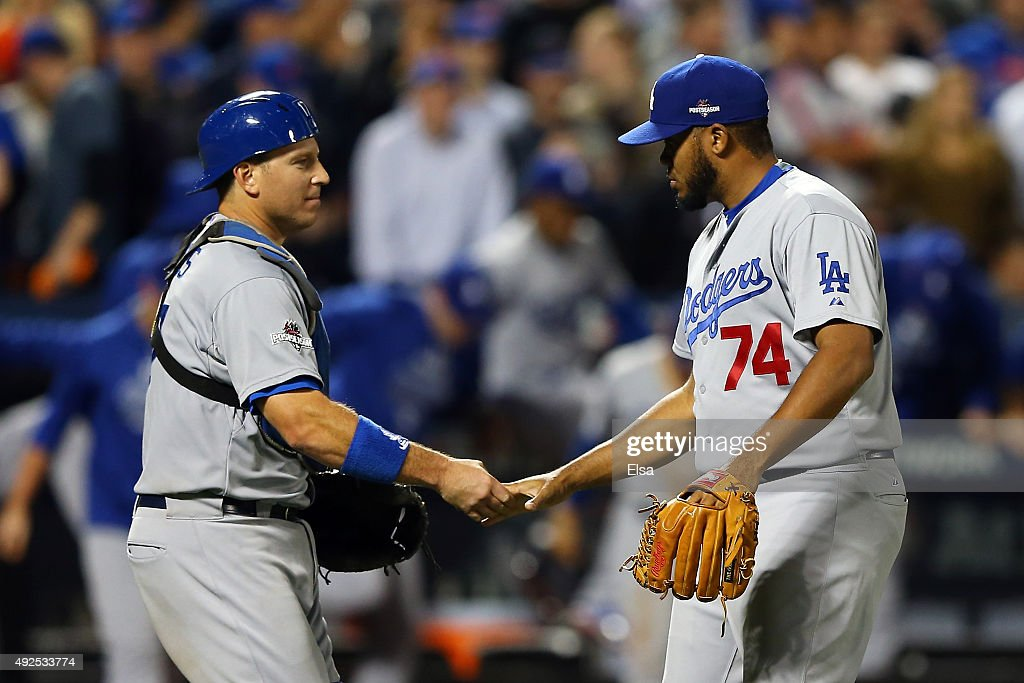 A.J. Ellis #17 and Kenley Jansen #74 of the Los Angeles Dodgers of the Los Angeles Dodgers celebrate after defeating the New York Mets in game four of the National League Division Series at Citi Field on October 13, 2015 in New York City. The Dodgers defeated the Mets with a score of 3 to 1.