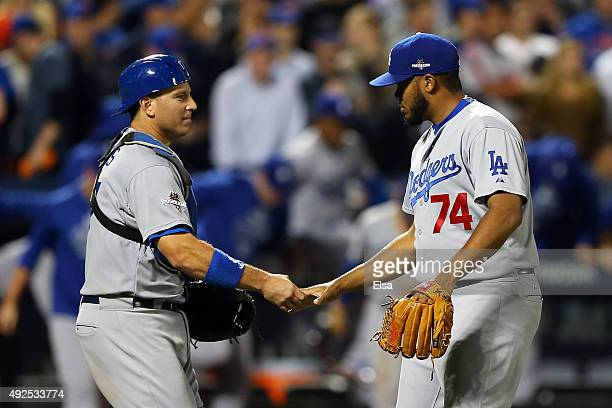 J Ellis and Kenley Jansen of the Los Angeles Dodgers of the Los Angeles Dodgers celebrate after defeating the New York Mets in game four of the...
