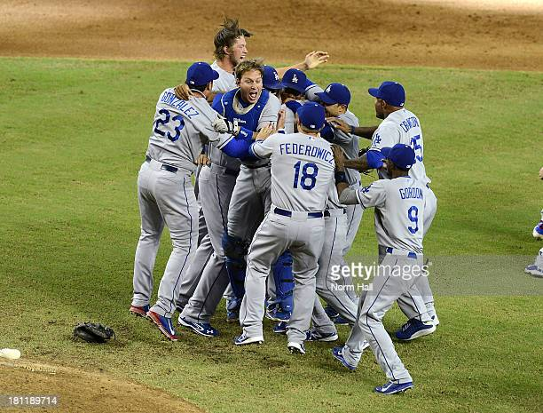 Ellis and teammates of the Los Angeles Dodgers celebrate clinching the National League West Division Title against the Arizona Diamondbacks after a...