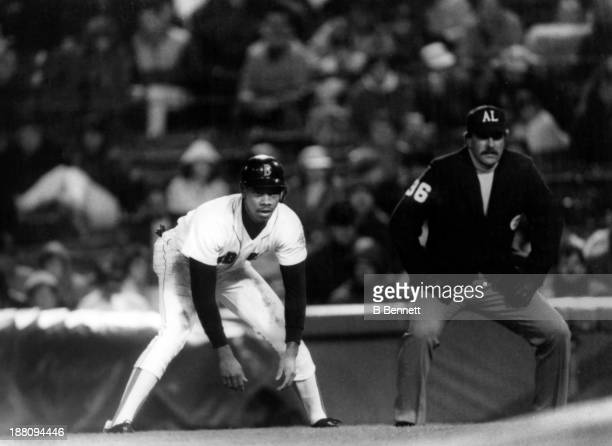 Ellis Burks of the Boston Red Sox leads of first base during an MLB game circa 1988 at Fenway Park in Boston Massachusetts