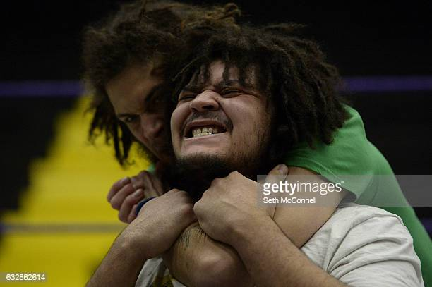 Ellis Ebersole aka Curtis Cole puts a chokehold on Dorian Richard aka Filter during a Mercury Pro Wrestling Academy class at the Jefferson County...