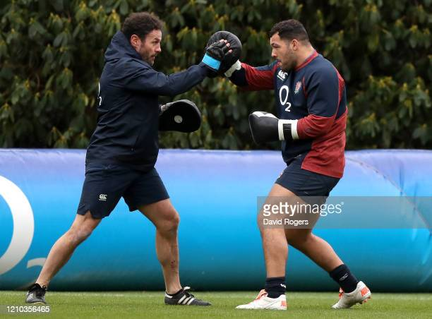 Ellis Genge of England boxes with a member of the coaching staff during a training session ahead of their Guinness Six Nations match against Wales at...