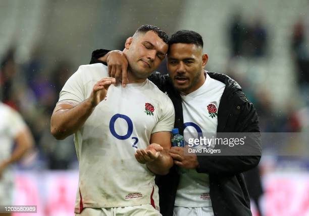 Ellis Genge of England is consoled by teammate Manu Tuilagi following their sides defeat in the 2020 Guinness Six Nations match between France and...