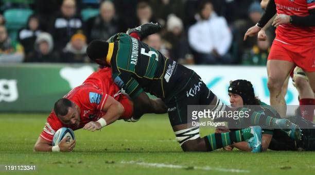 Ellis Genge of Leicester Tigers is tackled by Api Ratuniyarawa during the Gallagher Premiership Rugby match between Northampton Saints and Leicester...