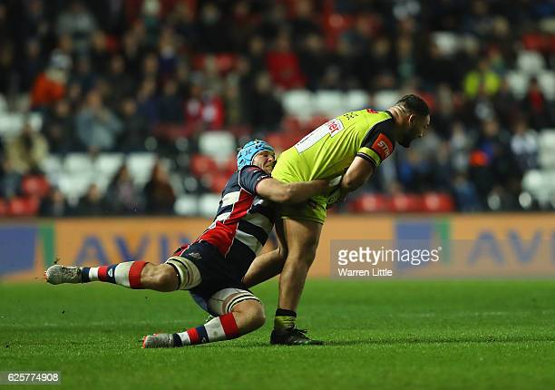 Ellis Genge of Leicester Tigers is tackled by Jordan Crane Captain of Bristol Rugby during the Aviva Premiership match between Bristol Rugby and...