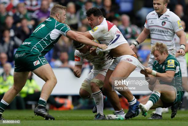 Ellis Genge of Leicester Tigers tackled by Scott Steele of London Irish and Harry Elrington of London Irish during the Aviva Premiership match...