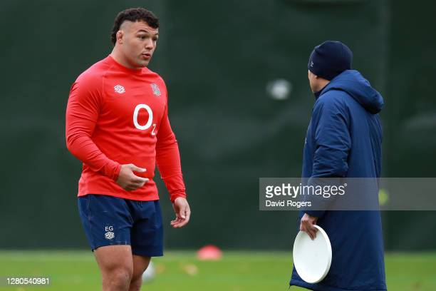 Ellis Genge speaks with head coach Eddie Jones during a warm up to an England training session at The Lensbury on October 16 2020 in Teddington...