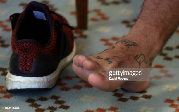 Ellis Genge the England prop shows off his tattoos on his right foot depicting the countries he has toured with England during the England media...
