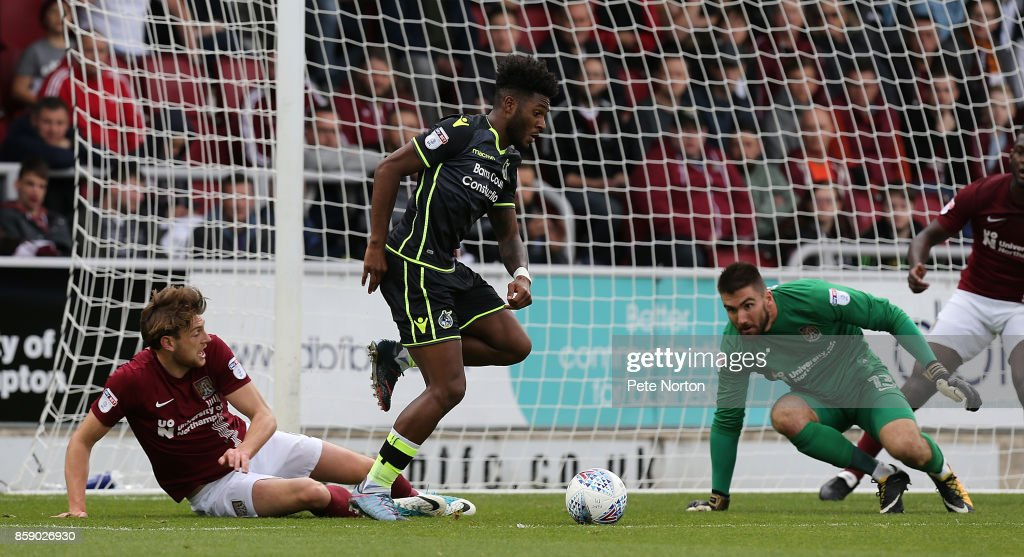 Ellis Harrison of Bristol Rovers moves past the challenge of Ash Taylor of Northampton Town during the Sky Bet League One match between Northampton Town and Bristol Rovers at Sixfields on October 7, 2017 in Northampton, England.